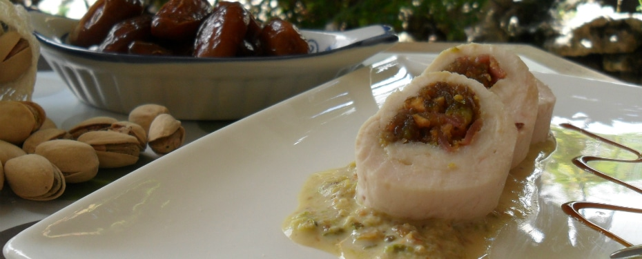 Chicken roll filled with bacon, dates and pistachios